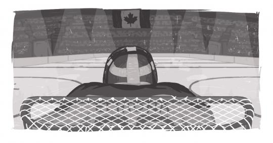 An image of a goalie, looking down the ice at a Canadian flag.