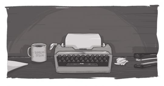 An image of a typewriter, with a coffee mug next to it.