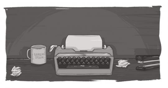 An image of a typewriter and coffee mug on a desk.
