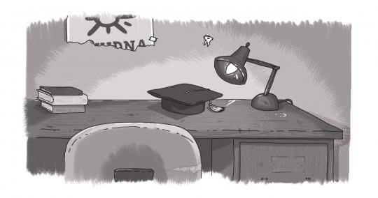 An image of a school desk with a mortarboard on it.