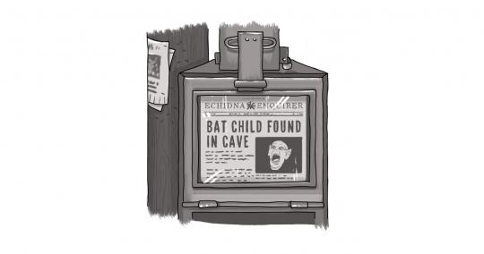 An image of a newspaper in a box, with a Bat Boy headline and screaming Bat Boy image.