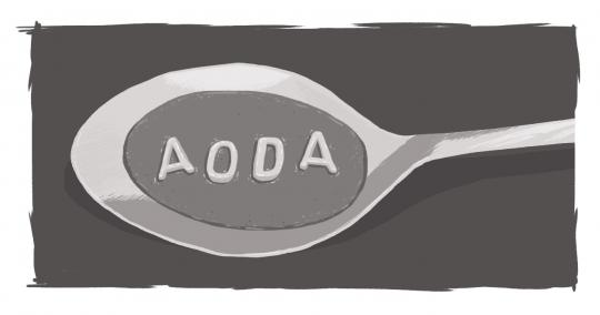 An image of alphabet soup in a spoon, spelling out AODA.